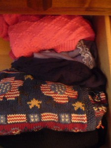 Keep like with like, as I keep my sweaters together in one drawer